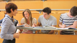 Students sitting at the desk at the lecture hall Stock Video Footage