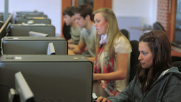 Students working in a computer class Footage