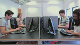 Students in a computer class working Footage