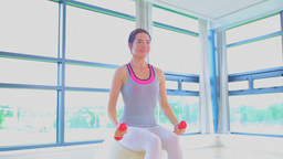 Woman doing exercise ball and dumbells Footage