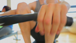 Brunette man working out on row machine Footage