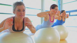 Women doing exercise balls in fitness studio Footage