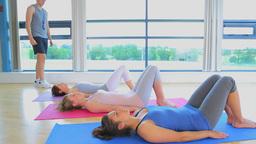Three women stretching their bodies Stock Video Footage