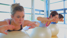 Video of focused women using exercise balls Footage