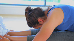 Video of a woman in seated forward bend yoga pose Footage
