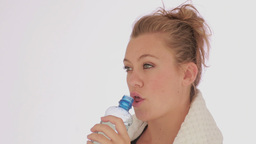 Woman drinking bottled water Stock Video Footage