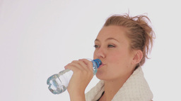 Woman drinking bottled water after doing sports Stock Video Footage
