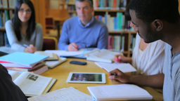 People studying together in library Stock Video Footage