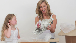Video of mother and daughter unpacking mugs Footage