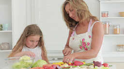 Mother and daughter preparing vegetables Stock Video Footage