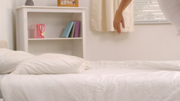 Woman falling on her bed Stock Video Footage