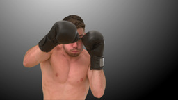 Man practicing boxing on black background Stock Video Footage