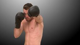 Brunette man parcticing boxe on black background Footage