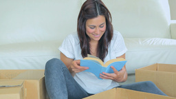 Woman unpacking the books Footage