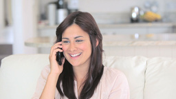 Woman calling in living room Stock Video Footage