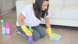 Woman cleaning the floor in the living room Footage
