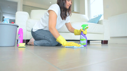 Woman cleaning a floor living room Footage