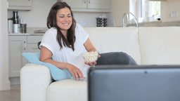 Video of woman enjoying tv with popcorn Stock Video Footage