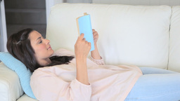 Video of concentrated woman reading a novel Footage