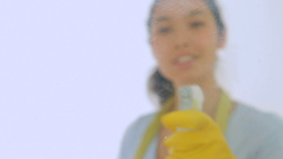 Smiling woman with cloth and spray bottle Stock Video Footage