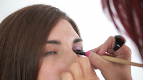Woman getting applied cat eyes Footage