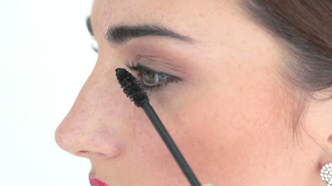 makeup artist applying mascara Stock Video Footage