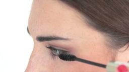 makeup artist applying mascara Stock Video Footage