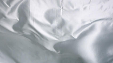 Silk bed sheet moving like waves Footage