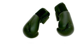 Green boxing gloves falling on the floor Live Action