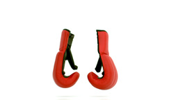 Red and black boxing gloves falling on the floor Live Action