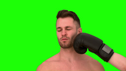 Man taking a punch on green background Footage