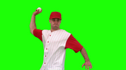 Brunette man throwing a baseball on green backgrou Footage