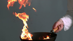Peppers burning in a pan with big flame in slowmot Stock Video Footage