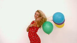 Woman holding colored balloons Stock Video Footage