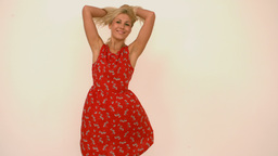 Woman revolving in a summer dress Stock Video Footage