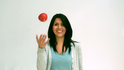 Woman throwing a apple in the air Stock Video Footage