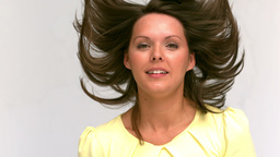 Brunette woman tossing her hair Footage