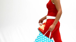 Woman walking with shopping bags Stock Video Footage