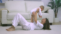 Mother playing with her child on the floor Footage