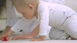 Mother and baby playing on the floor Stock Video Footage