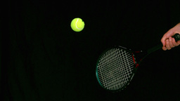 Tennis ball bouncing on a racket Stock Video Footage