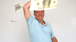 Happy man throwing dollars Footage