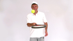 Tennis man juggling with his racket Footage