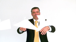 Smiling businessman throwing papers Stock Video Footage