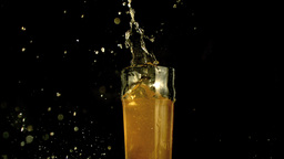Pint of beer splashing Footage