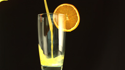 Orange juice pouring into a glass Footage