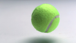 Tennis ball rebounding in slow motion Stock Video Footage