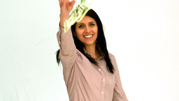 Happy woman throwing bills Stock Video Footage
