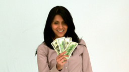 Smiling woman fanning bills Footage