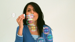 Beautiful woman blowing bubbles Footage